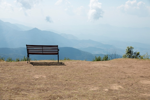 Wooden bench outdoor landscape with mountains view.