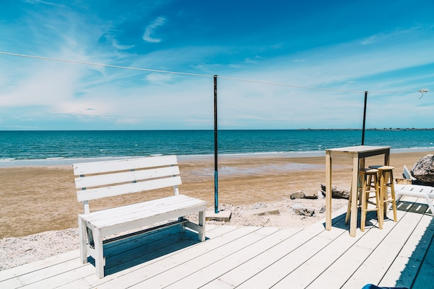 Wooden bench and table at the beach