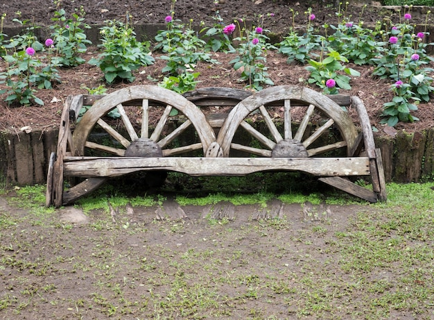 Wooden bench which made from the old cart wheel.