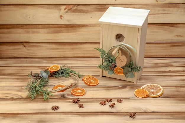 Wooden birdhouse to give as a gift with decorative orange slices