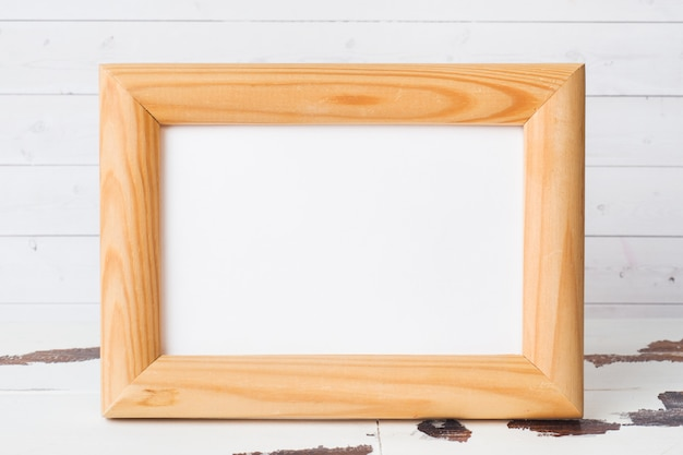 Wooden blank picture frame on white background.