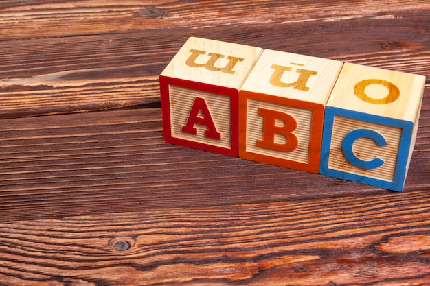 Wooden block alphabet lay on wooden floor