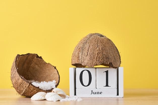 Wooden block calendar and coconut