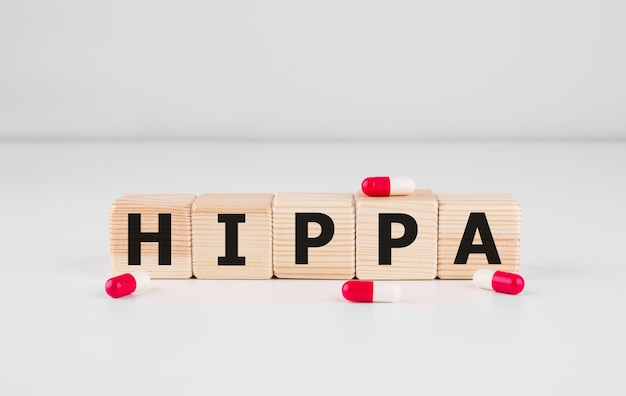 Wooden block form the word hipaa health insurance portability and accountability act on white. medical concept.
