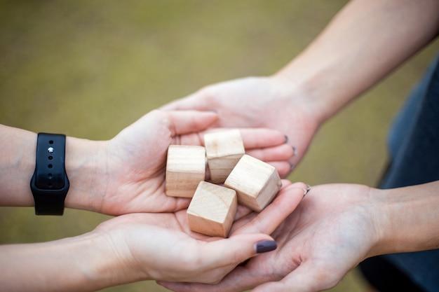 Wooden block in hands to hands