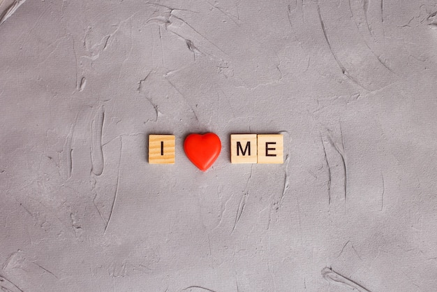 Wooden block letters with written quote: i love me. concept of accepting myself.