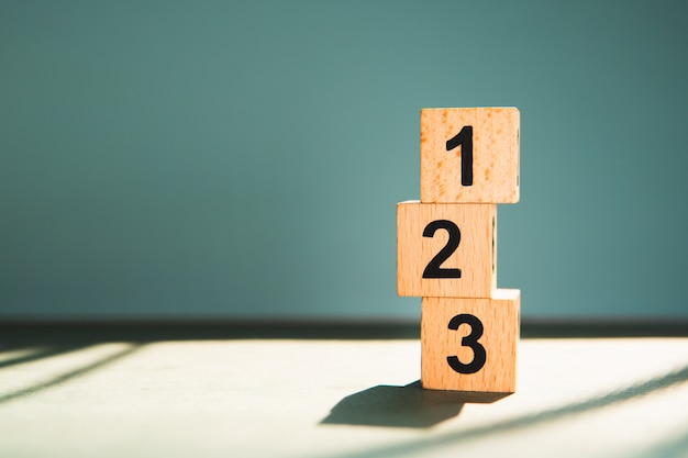Wooden block number using as business competition concept