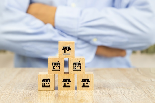 Wooden block stacked with franchise icon.