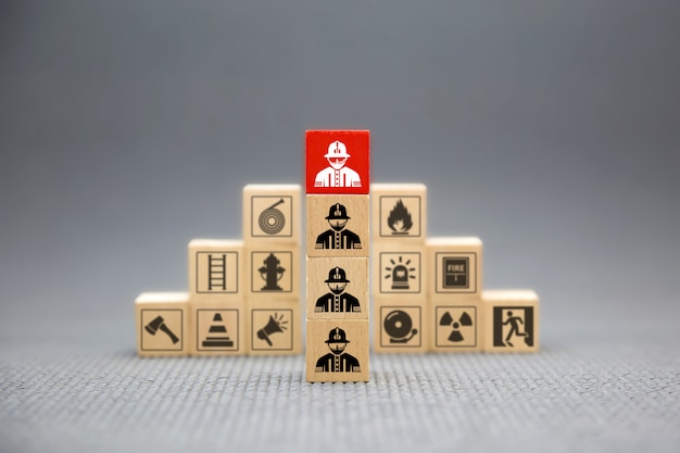 Wooden block with firefighter icon for fire and safety .