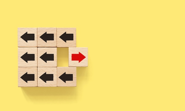Wooden block with red arrow facing the opposite direction black arrow