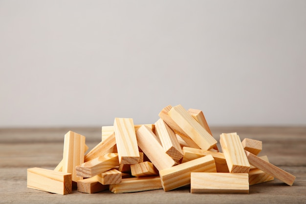 Wooden blocks disrupted on grey wooden background