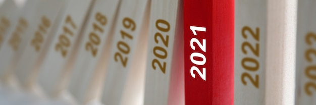 Wooden blocks listing years rested in red since 2021.