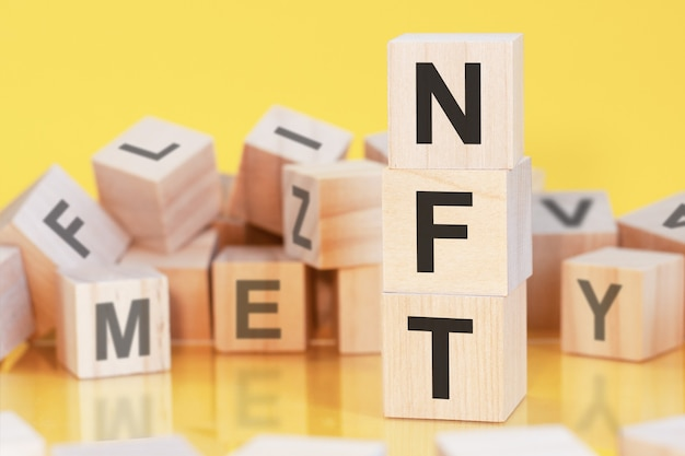 Wooden blocks nft - non-fungible token. selling digital assets and art through auctions. blockchain technology. monetization, investment in cryptographic tokens