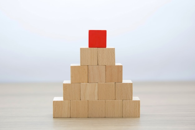 Wooden blocks stacked intro pyramid shape