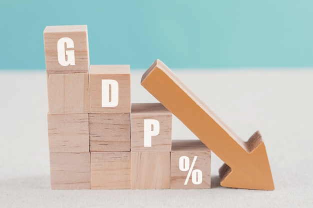 Wooden blocks with gdp% and orange down arrow