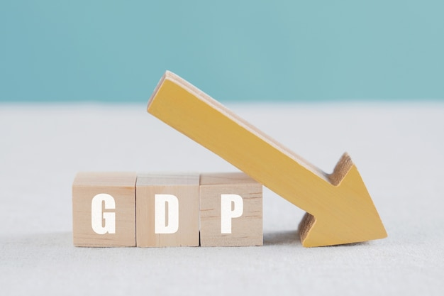 Wooden blocks with gdp word and yellow down arrow