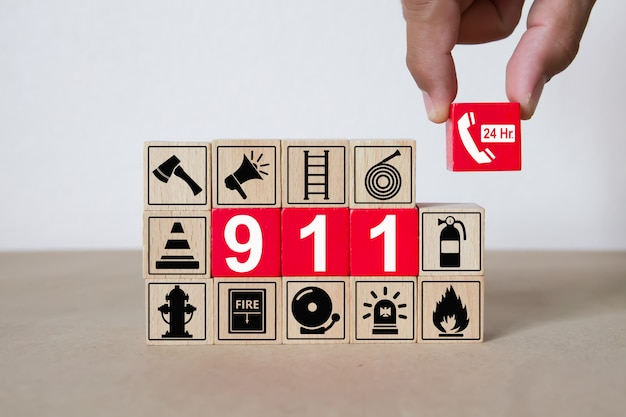Wooden blocks with graphics 911 emergency number.