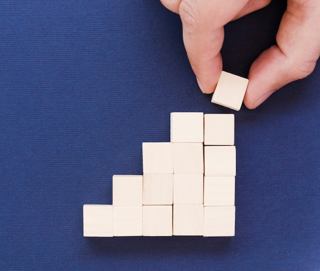 Wooden blocks with hand