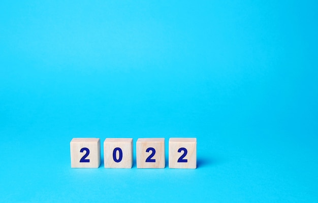 Wooden blocks with the inscription 2022 setting goals and objectives for the new year planning