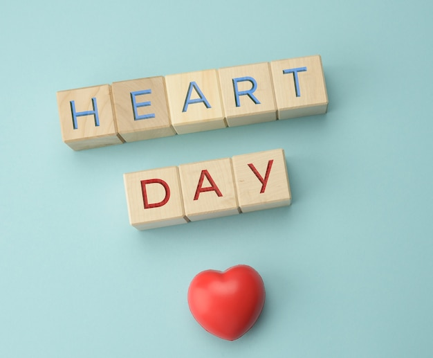 Wooden blocks with the inscription heart day. concept for health care, annual check of human organs, prevention of diseases