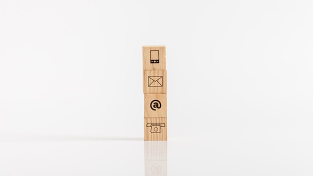 Wooden blocks with means of communications icons against white background.