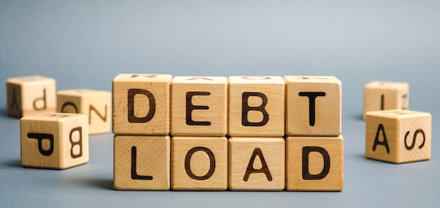 Wooden blocks with the word debt load.