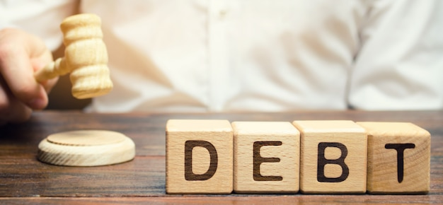 Wooden blocks with the word debt