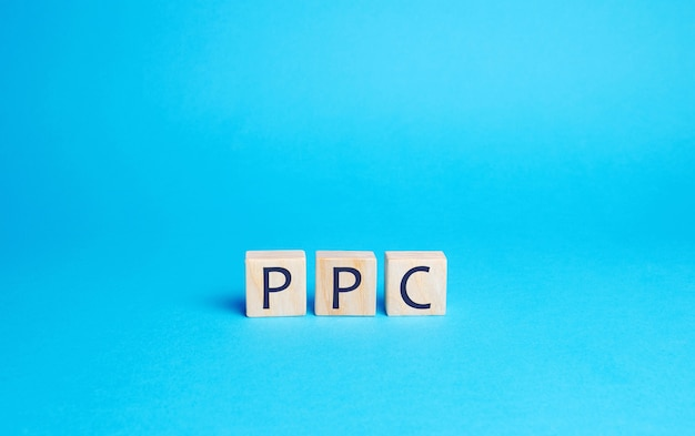 Wooden blocks with the word ppc. internet advertising model used to drive traffic to websites