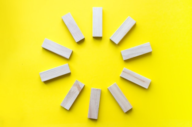 Wooden blocks on yellow. business planning, risk management, solution, leader, strategy, different