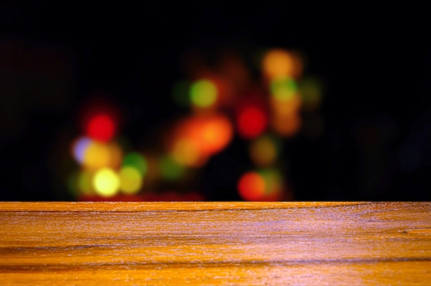 Wooden board empty table in front of colorful bokeh light in the night