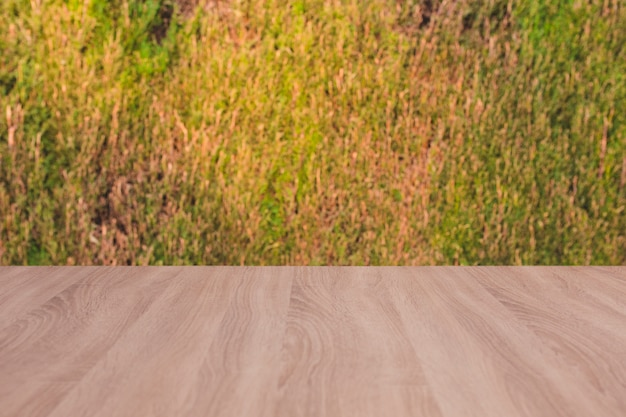 Wooden board empty table with grass background