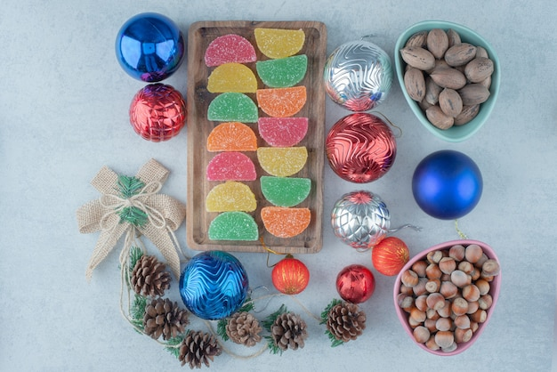 A wooden board full of with christmas balls and pinecones. high quality photo