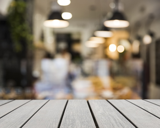 Wooden board looking out to blurred bar