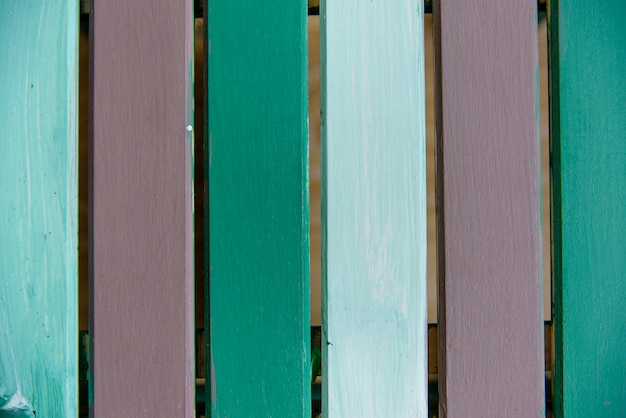 Wooden board painted green brown old style abstract background.