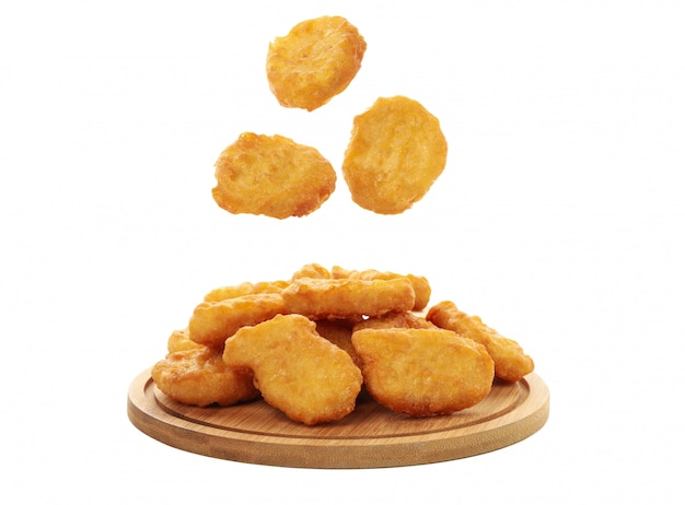 Wooden board with chicken nuggets isolated on white background