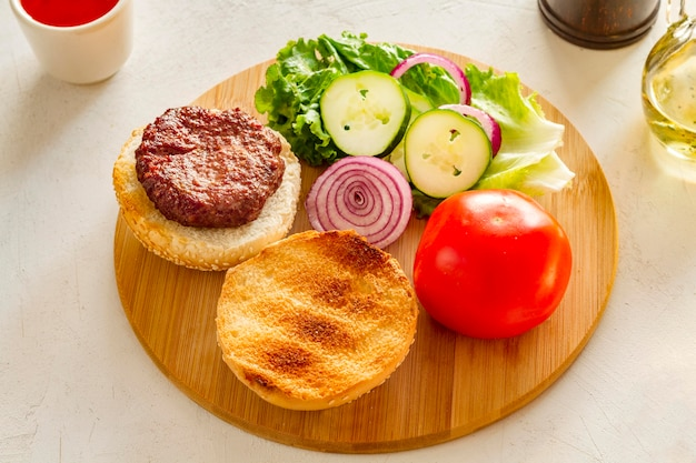 Wooden board with hamburger on table