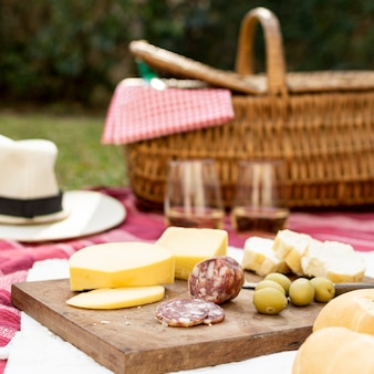 Wooden board with picnic goodies