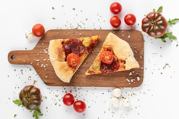 Wooden board with pizza