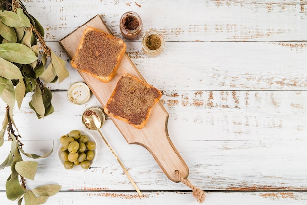 Wooden board with sandwiches