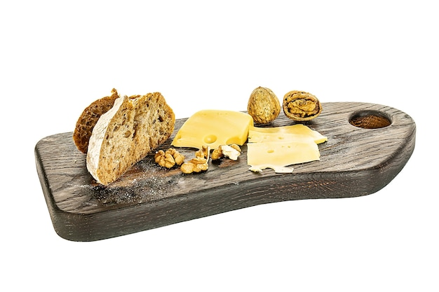 Wooden board with tasty cheese on white background.