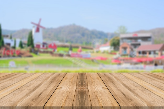 Wooden board with a village out of focus background