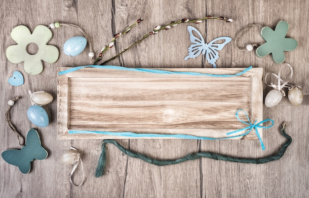Wooden board on wood background with spring decodations