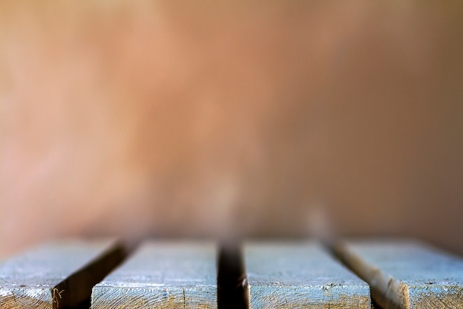 Wooden boards empty table top with blurred background.