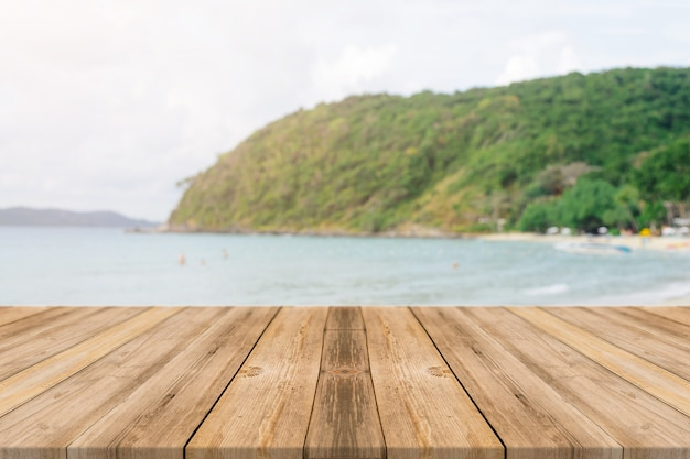 Wooden boards with blurred beach background