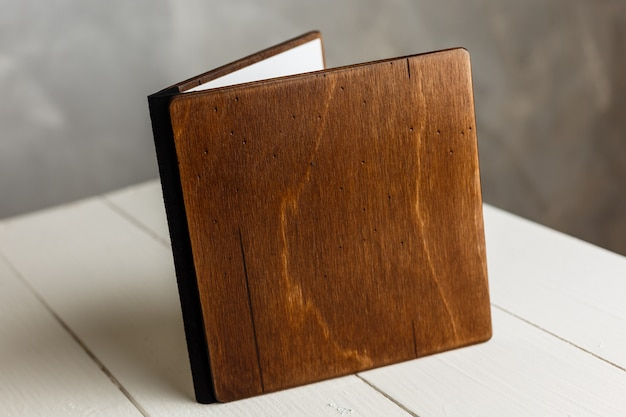 Wooden book on a white