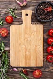 Wooden bottom with tomatoes