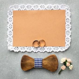 Wooden bow tie copy space wedding beauty concept