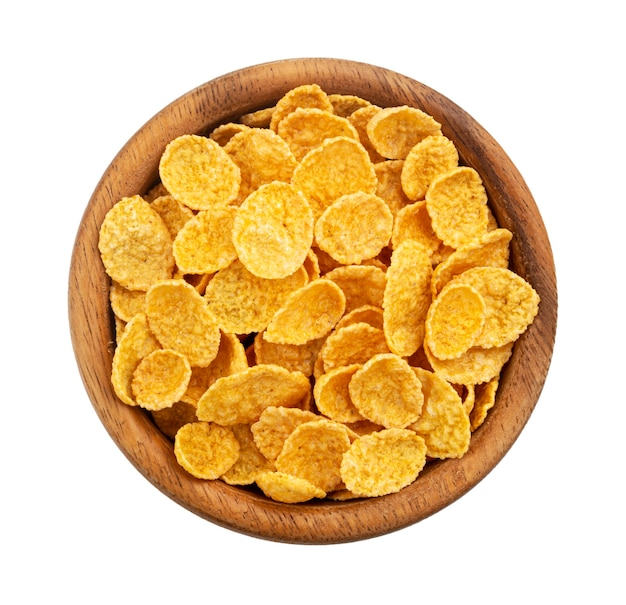Wooden bowl of corn flakes isolated on white background top view