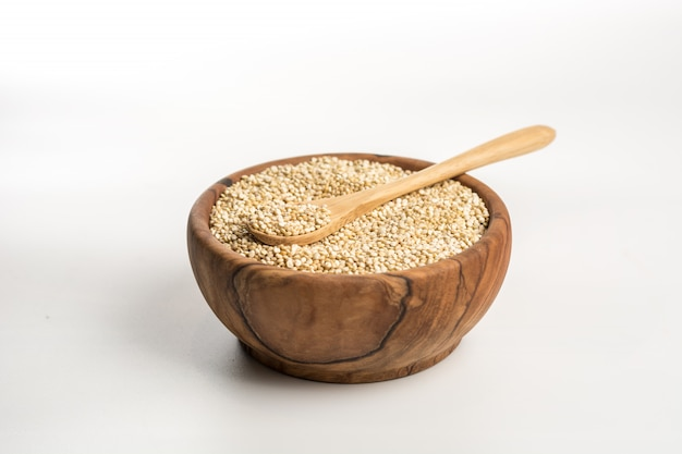 Wooden bowl full of quinoa.