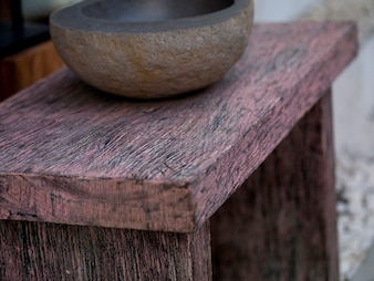 Wooden bowl on a stool